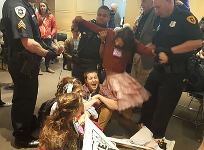 "Demonstrators are forcibly removed from today's ""Keep It in the Ground"" rally in Salt Lake City. Photo by Valerie Love, Center for Biological Diversity. Photos are available for media use."